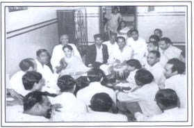 Young Geeta singing in a group
