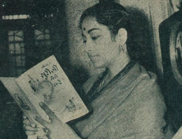Geeta Dutt reading a magazine